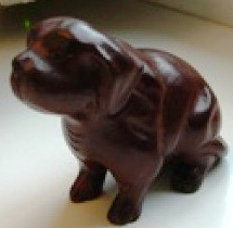 Rosewood dog, hand-carved in traditional business.family
